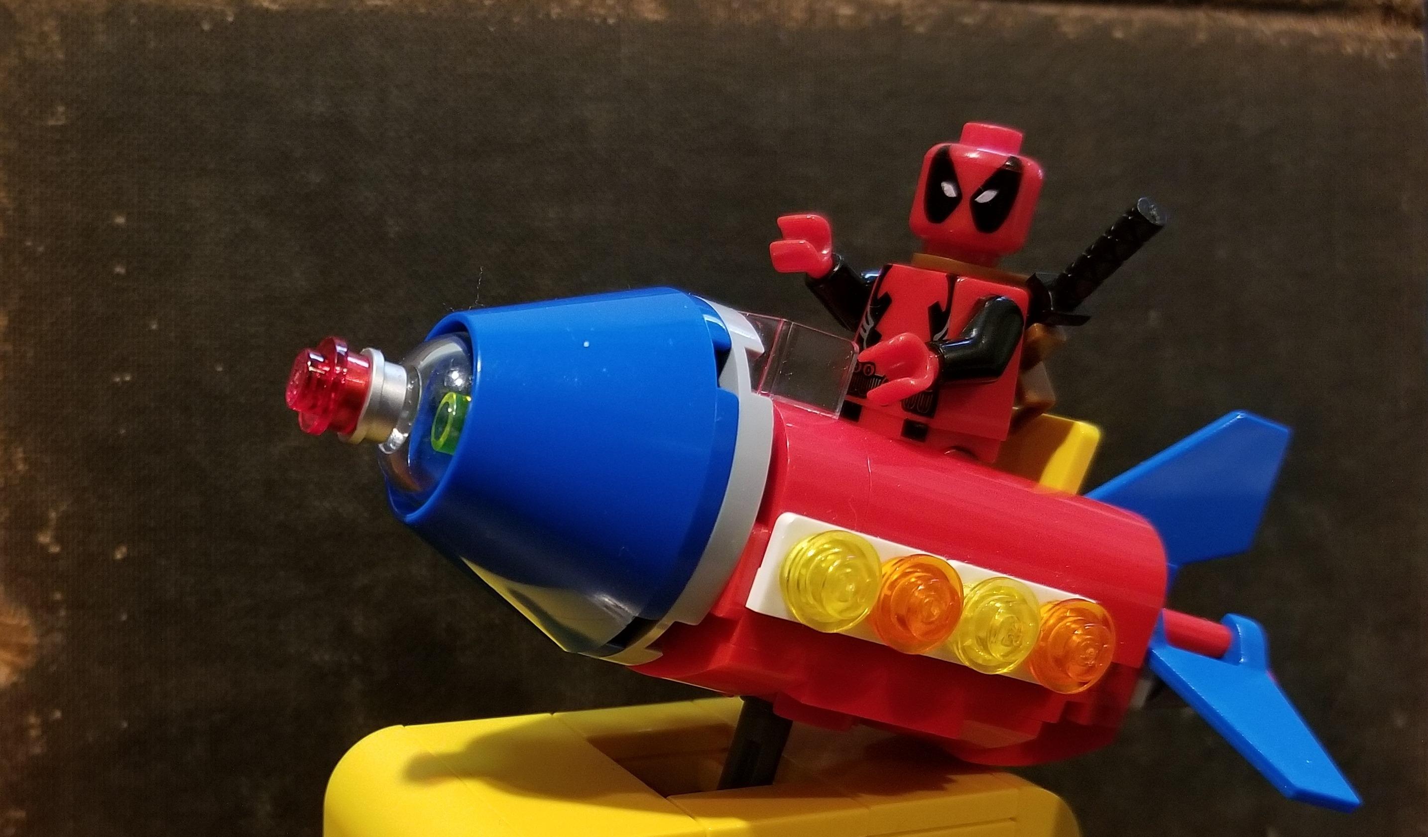 Lego Deadpool on a Rocket Ride